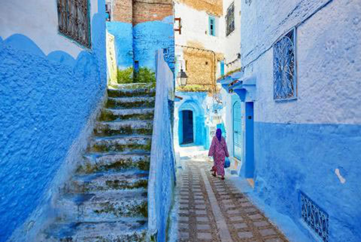 casa blanca streets with bright blue painted steps