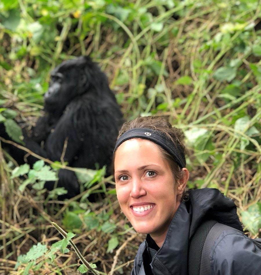 Guide Kayla Peckford next to gorilla